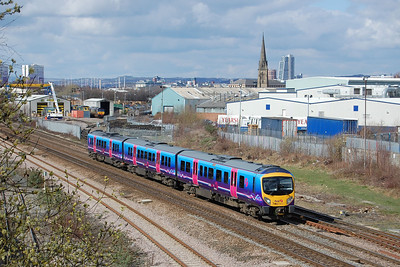185117 passes Freightliner's Midland Road depot at HUnslet with the diverted 1F66 1108 Newcastle-Liverpool. The greenery in the foreground is a deliberate attempt to 'frame' the subject at what is a location more suited to lengthy freight trains (18/03/2012)