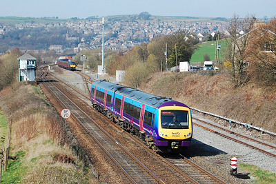 TransPennine Express' 170303 passes the signal box at New Mills South Junction with 1B78 1255 Manchester Airport-Cleethorpes. Waiting patiently in the background is the object of today's exercise (29/03/2012)