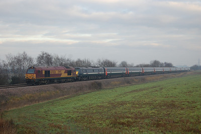 67026 drags 91121 on the approach to Micklefield with 1D13 1203 Kings Cross-Leeds, which had been diverted via Hambleton due to engineering work at Beeston. Typically this scene would have been bathed in low winter sunshine just forty minutes later, so on this occasion three miles of walking on a cold Sunday afternoon didn't  quite pay off. We've all been there though (15/01/2012)