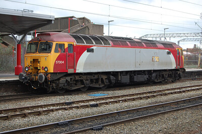 With its days as a 'Virgin Trains' locomotive numbered (the 'Gordon Tracy' nameplates have already been removed), 57304 waits to attach to 1D83 0850 Euston-Holyhead in Platform 12 at Crewe station. The locomotive was transferred to DRS a couple of weeks later (17/03/2012)