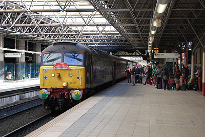 With some of its passengers waiting to greet it on the platform, the empty stock for the 'Africa Express' arrives at Manchester Victoria from Crewe behind 47810 (06/09/2012)