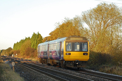 142042 catches the early morning sun as it accelerates away from Cross Gates at Manston whilst working ???? (27/10/2012)