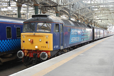 A week later, 47818 is pictured arriving at Glasgow Central with 5Z89 0938 empty stock from Polmadie for a Cruise Saver charter to Southampton (18/11/2012)