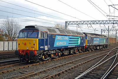 47805+47813 had charge of 1Z89 1104 Glasgow Central-Southampton, but a suspected fault with the latest addition to DRS' operational '47' led to is being detached at Carlisle, where the pair are pictured entering one of the middle roads (18/11/2012)