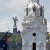 Quito - Top of Metropolitan Cathedral with the statue of Virgin of El Panecillo in the background