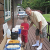 ALEX HELPS WITH THE FISH FRY ON THE DECK