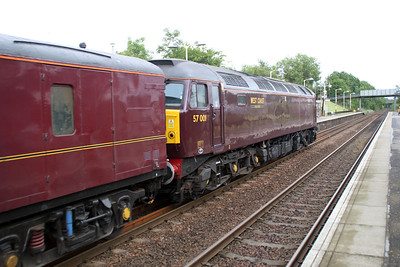57001 1353/1z10 Carnforth-Keith 'Queeen of Scots' set approaches /passes Greenfaulds Station.