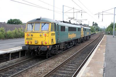 86613_86628 1839/0L81 Mossend-Coatbridge FLT pass Coatbridge Central.