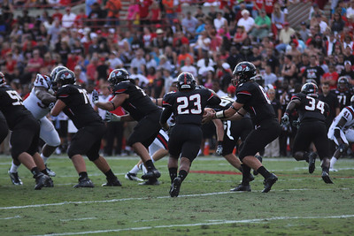 Lucas Beatty, 8 passes the ball off to 23, Juanne Blount for an attempted first down.