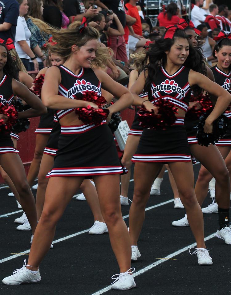 Kaitlynn Watts and Jessica Saltjeral cheer on the Runnin' Bulldogs.