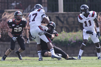Tanner Buch (55) gets a tackle for GWU