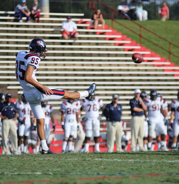 Samford's, 95, Greg Peranich punts the ball down the field.