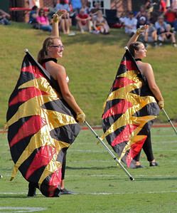 The colorguard perform at the halftime show.
