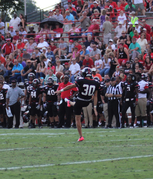 Bo Lindsey, 30 punts the ball down the field.