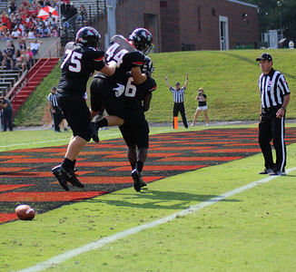 75, David McConnell 44, Hudson Smith and 6, Kenny Little celebrate a GWU touchdown.