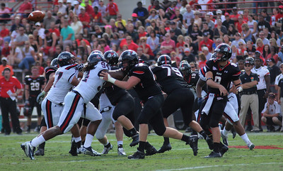 Lucas Beatty,8 passes the ball off to a team mate. While the offensive line blocks Stamfords defensive line.