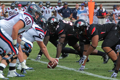 Gardner-Webb's defensive line prepares for Samford to hike the ball.