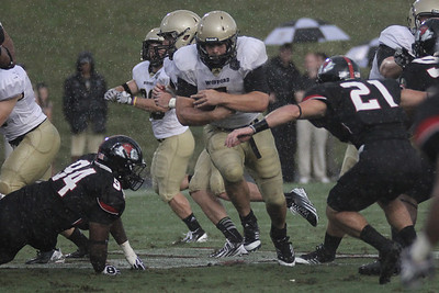 Defensive players Gianni Olivas (21) and Zach Shelton (94) try to take down Wofford