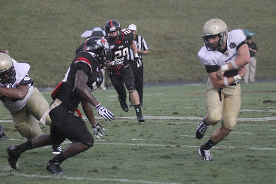Wofford holds onto the ball as Gardner-Webb gets ready for the tackle