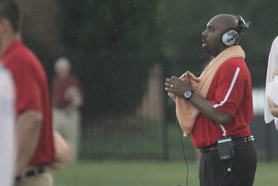 Head Coach Ron Dickerson keeps a towel handy to stay as dry as possible during the soaking wet open seasoner game against Wofford Saturday, September 1, 2012