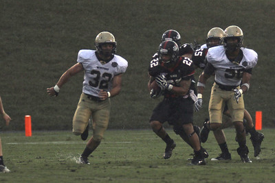JJ Hubbard (22) runs the ball as the Runnin' Bulldogs take on the Wofford Terriers for a rainy season opener on September 1, 2012