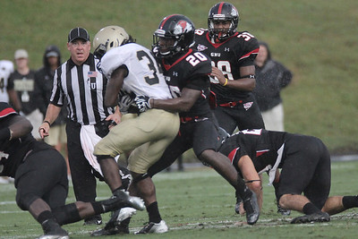 Defensive player Bobby Clark (20) fights to take down Wofford's player
