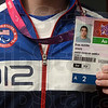 Tribune-Star/Joseph C. Garza<br /> Credentialed athlete: Paralympic swimmer Austin Evan displays the credential he used in London Thursday at his home in Riley.