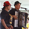 Tribune-Star/Jim Avelis<br /> Polka time: Anna and Joe Polach lead the singing for the St. Louis Express, one of the polka bands performing at the Oktoberfest in the Clabber Girl parking lot through Saturday.