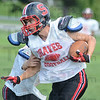 Tribune-Star/Jim Avelis<br /> Breaking free: Tyler Seibert breaks loose from a team mate during practice Wednesday evening.