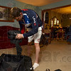 Tribune-Star/Joseph C. Garza<br /> On the road again: Paralympic swimmer Evan Austin talks to his dad, Eric, as he repacks his bags Thursday at his home in Riley. Austin was preparing to go to the airport for a flight to Washington, D.C.