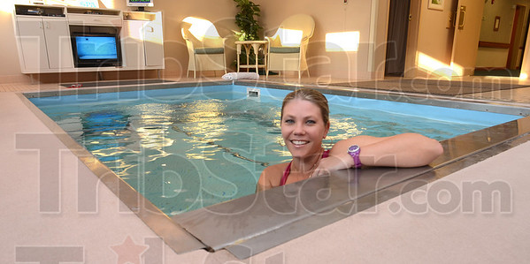 Tribune-Star/Jim Avelis<br /> Cutting edge: PTA Alicia Thome rests at the edge of the aquatic therapy pool  in Providence Health Care's newly opened short term rehabilitation unit. The pool is one of only fur in the state.