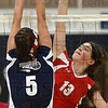 Tribune-Star/Jim Avelis<br /> Spiked: Terre Haute South's Meaghan Etling spikes the ball past the defense of Terre Haute North's Mandee Eberle in their Volleyball For The Small game Thursday night in the Patriot's gym.