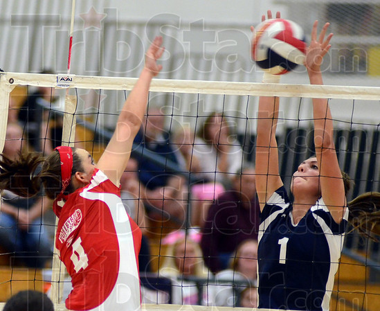 Tribune-Star/Jim Avelis<br /> Not here: Terre Haute South's Elizabeth Weber gets her spike blocked by Terre Haute North defender Anna Taylor in the first game of their Volleyball For The Small match Thursday night.