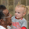 Tribune-Star/Jim Avelis<br /> Old friends: Russel Coutinho, neonatologist at Union hospital holds Aubrey Butts, whom he cared for for about 100 days after her premature birth. They were at the Volleyball For The Small game at Terre Haute North high school Thursday night.