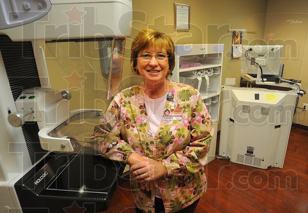 Tribune-Star/Jim Avelis<br /> At home: Michelle McCrea with one of the digital mammography units in the Clara Fairbanks Center for women.