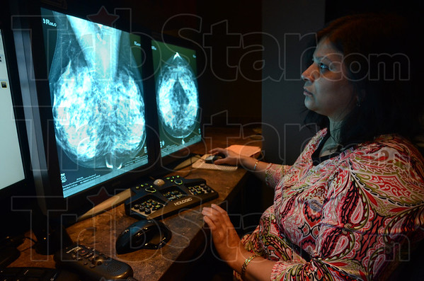 Tribune-Star/Jim Avelis<br /> Looking: Radiologist Rita Ratani looks over mammograms in the Clara Fairbanks Center for women.