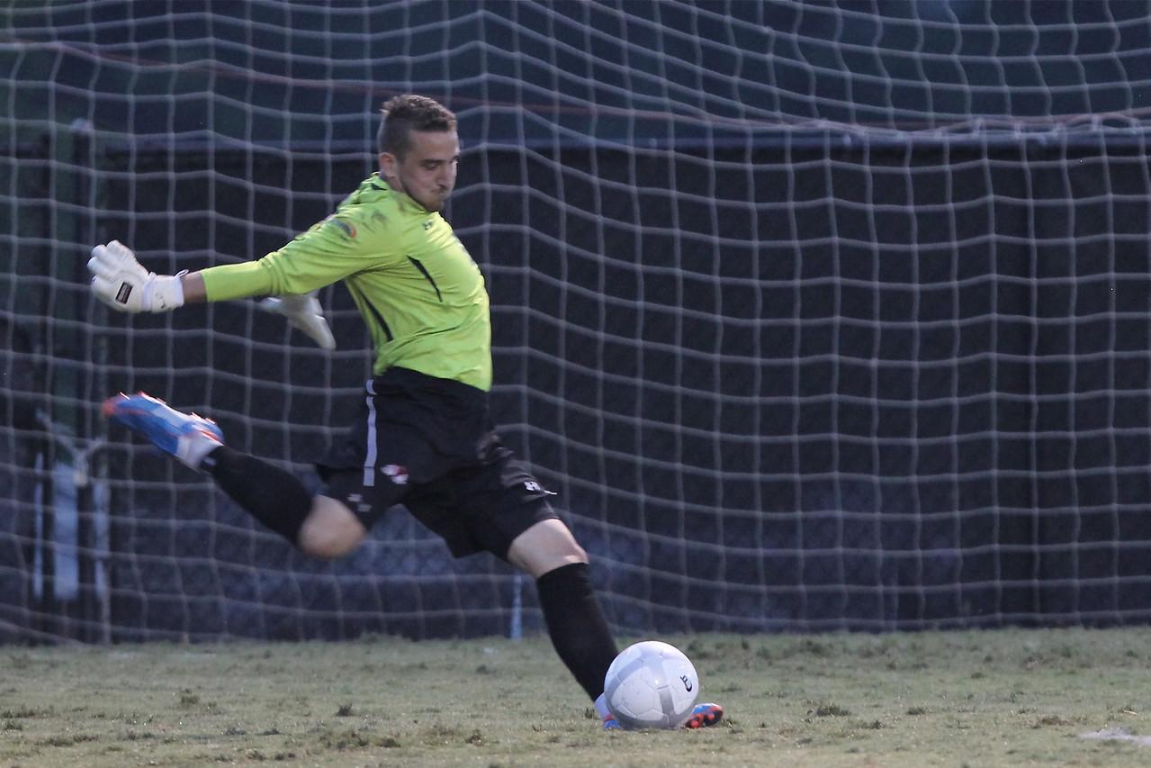 Scott Krotee (0) kicks the ball