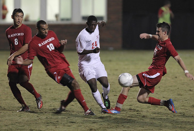 Kevin Comvalius (24) fights through Radford's players
