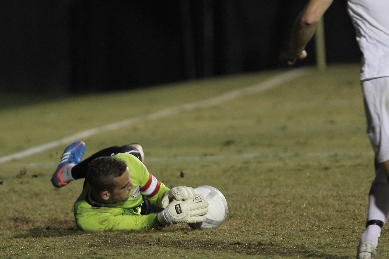 Scott Krotee (0) blocks a goal