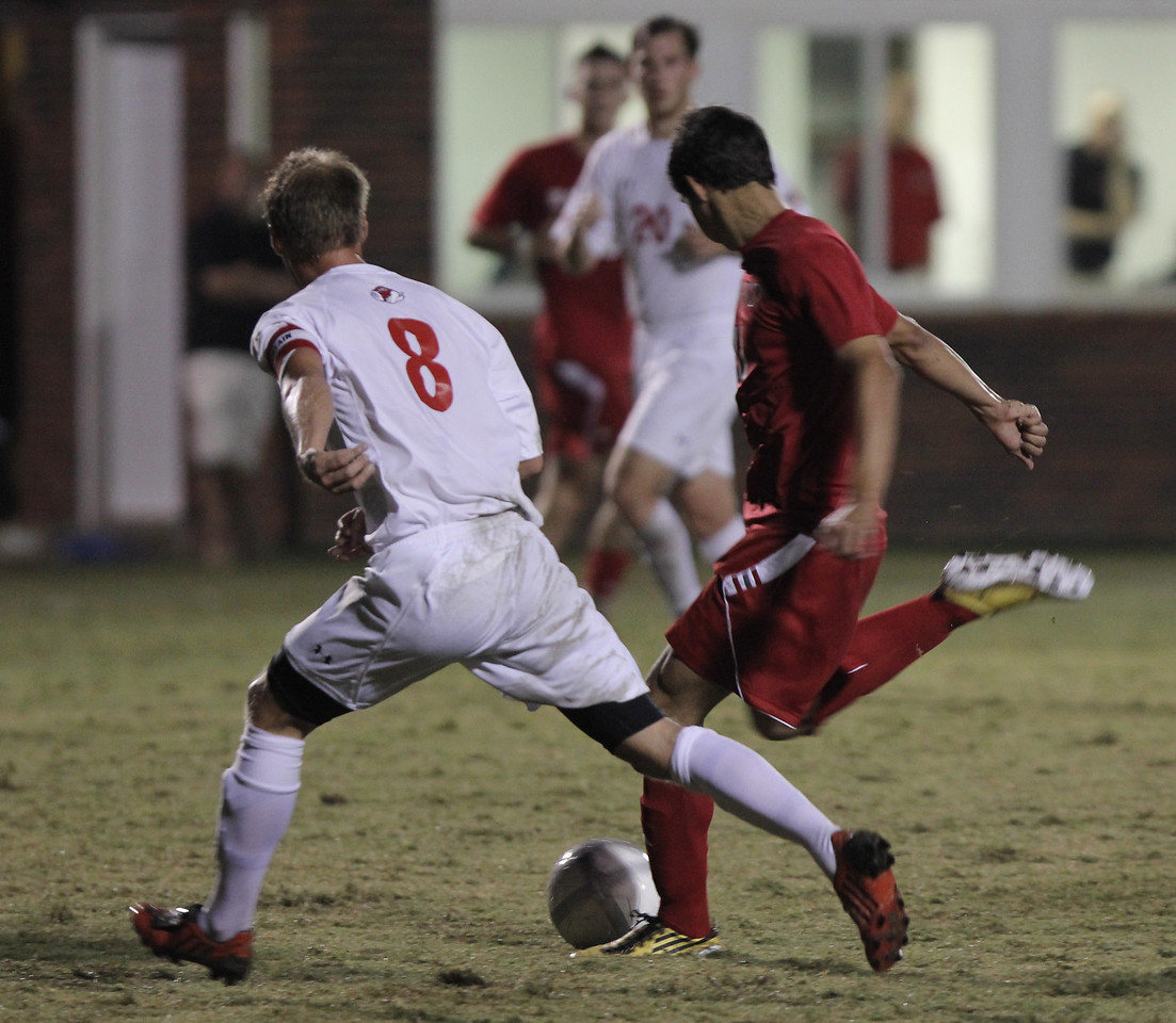 Marius Hammersmark (8) fights to get possession of the ball