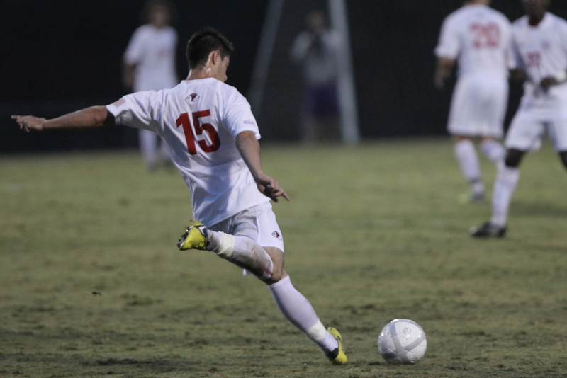 Mike Ellis (15) kicks the ball