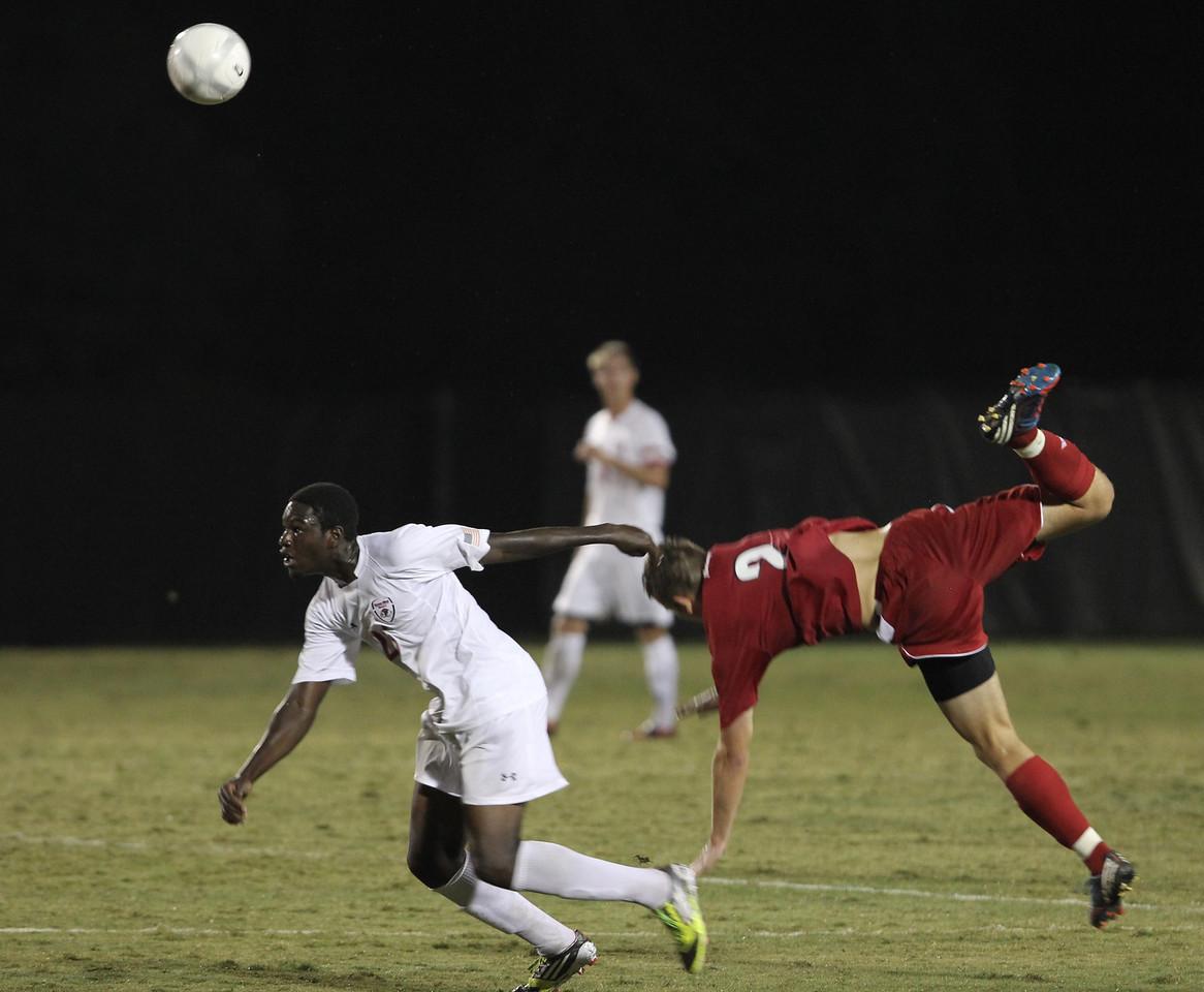 Denzel Clarke (25) looks for the ball