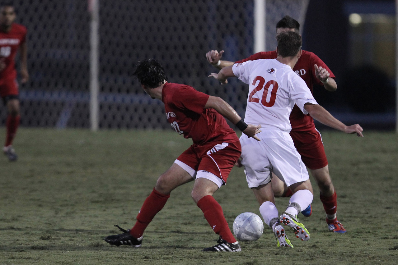 John Sargent (20) fights against Radford's players to get possession of the ball