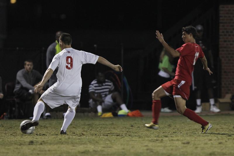 Jordan Day (9) kicks the ball away from Radford's player