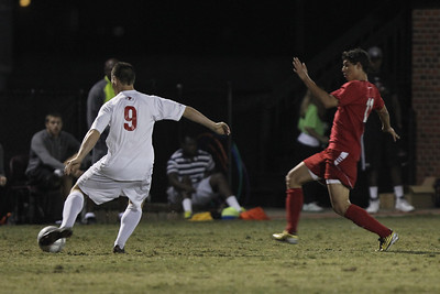 Jordan Day (9) kicks the ball away from Radford's player