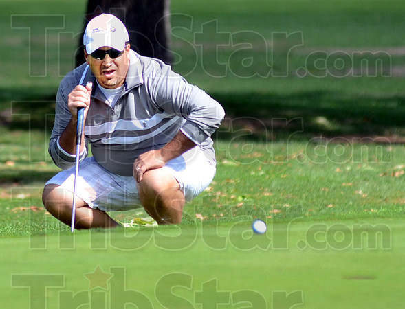 Ryan eyesl: Ryan Roscoe reads his lie during Sunday's final round of the Men's City Tournament at Rea Park.