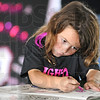 Concentration: Five-year-old Coee Neice colors in her book while attending Sunday's Nana's Fight Club for the cure event.
