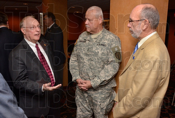 Tribune-Star file photo/Joseph C. Garza<br /> Before the signing: Senator Thomas Wyss talks with the Adjutant General of Indiana, Major General R. Martin Umbarger, and Indiana State University President Dan Bradley before Umbarger and Bradley signed an agreement between the Indiana National Guard and Indiana State Monday, Dec. 5, 2011 on the ISU campus.