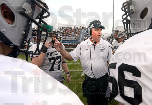 Let's go: Northview coach George Gettle encourages his players during a first quarter time-out. North was ahead 27-0 at the time.