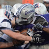 Hosted: Ben Davis running back Malcolm Fogle is swarmed under by a host of Terre Haute North tacklers in first quarter action Friday night on the Giant's field.